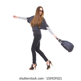 beautiful girl with long hair is in fashion style with bag