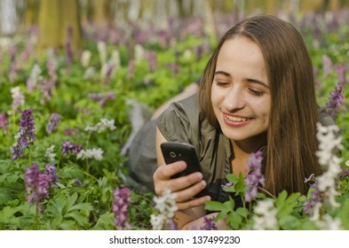 beautiful girl is looking at mobile in corydalis