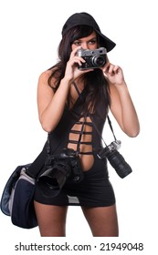 The beautiful girl looks forward, holds an old camera in hands