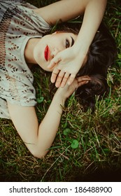 beautiful girl lying in the dry grass