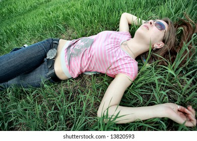 Beautiful girl lying on Grass