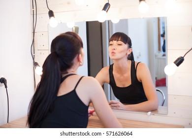 beautiful girl makes herself the makeup