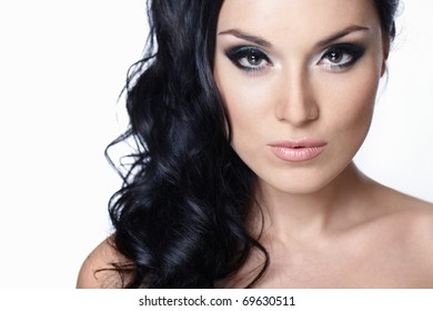 Beautiful girl with makeup and hair on white background