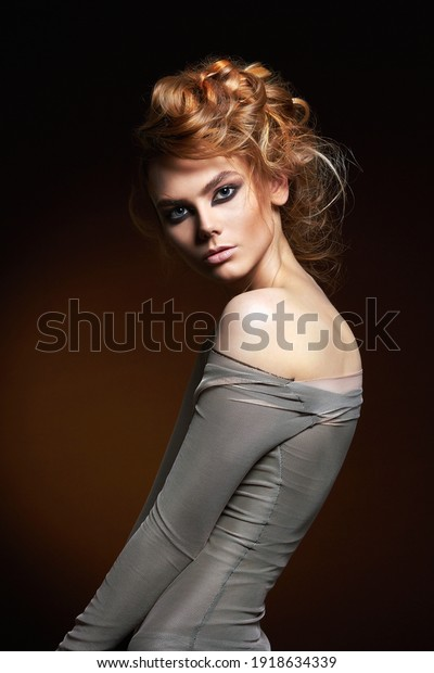 beautiful girl with make-up and Hair style. Beautiful young woman. Creative salon HairDo