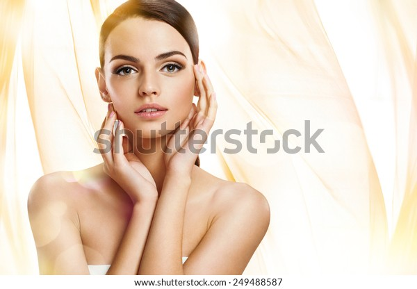 Beautiful girl with beautiful makeup, youth and skin care concept / photoset of attractive brunette girl on beige background