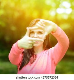 Beautiful girl making frame gesture