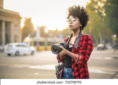 Beautiful girl making picture in a city