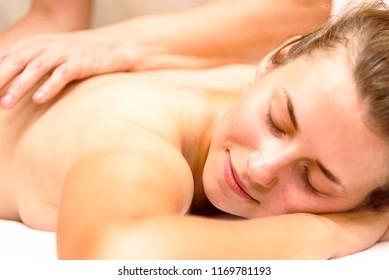 beautiful girl a man doing a massage