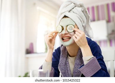 Beautiful girl with a mask on her face enjoys and relaxes.