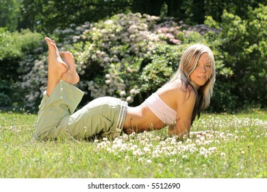 Beautiful girl in meadow with flowers