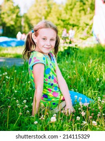 Beautiful girl in the meadow on a sunny summer afternoon.