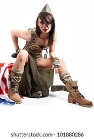 Beautiful girl in military clothes. studio shot
