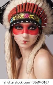 Beautiful girl in a military headdress.