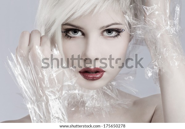 Beautiful girl model with plastic around her neck. Toned and professional makeup.