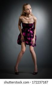 Beautiful girl model pose on gray background