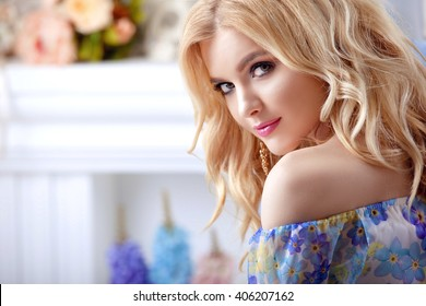 beautiful girl model woman portrait professional makiyad and hair in a flower dress on a floral background , bright tone , pink lips , blonde hair , blonde curls sound around , very cute and beautiful