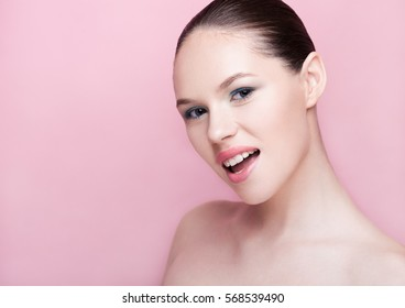 Beautiful girl natural makeup spa skin care on pink background