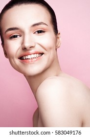 Beautiful girl natural makeup spa skin care on pink background with cute smile