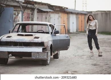 beautiful girl near the car