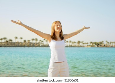 Beautiful girl near the sea