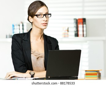 beautiful girl in office with laptop