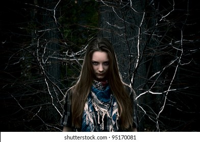 Beautiful girl on a background of branches