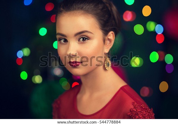 Beautiful girl on the background of the Christmas tree, close-up portraits, New Year's Eve