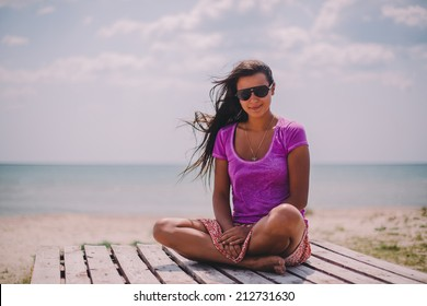 beautiful girl on the beach in spring time
