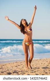 Beautiful girl on the beach wearing a bikini