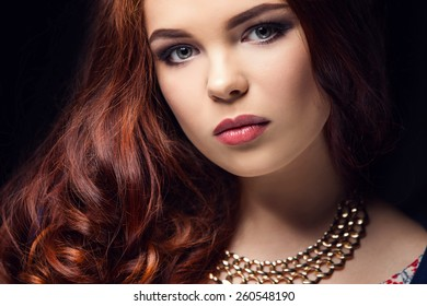 beautiful girl on a black background, fashion portrait.