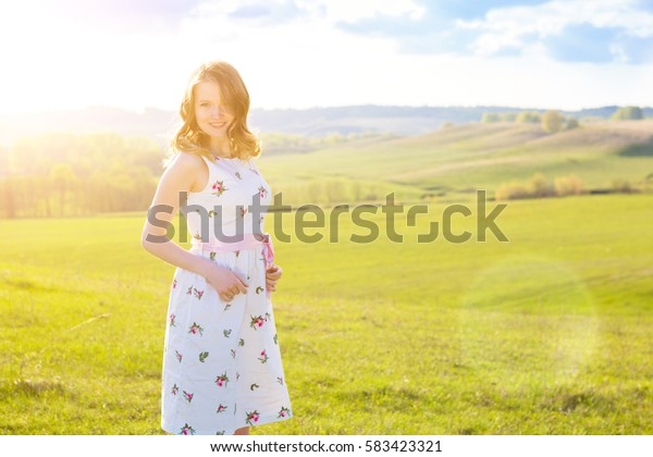 Beautiful girl on the field Beautiful blonde woman in the field on sunset Soft focus