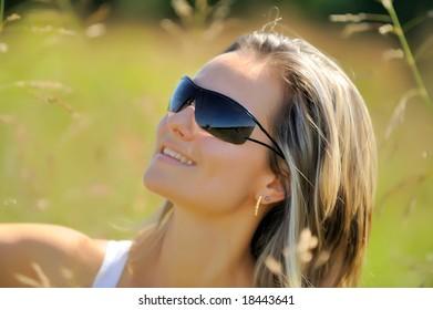 beautiful girl on field in summer