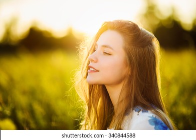 Beautiful girl on the flowers field Beautiful blonde woman in the flowers field on sunset  Soft focus
