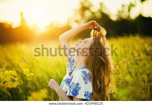 Beautiful girl on the flowers field Beautiful blonde,Healthy Lifestyle woman in the flowers field on sunset Soft focus,Summer scenes