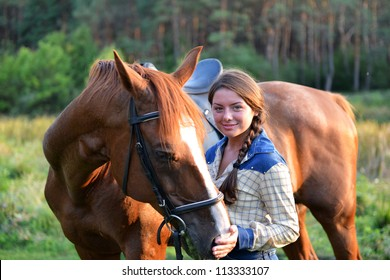 Beautiful girl on the forest with her horse.