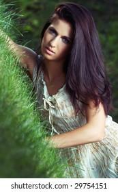 beautiful girl  on grass in beautiful  dress