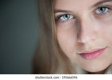 Beautiful girl on grey background