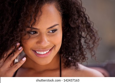 Beautiful Girl on her cell phone listening with a smile