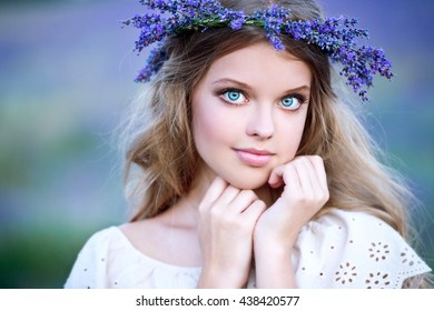 Beautiful girl on the lavender field. Girl with long hair collects lavender