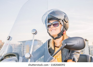beautiful girl on moped scooter