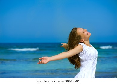 Beautiful Girl on the Ocean Beach. Travel or Vacation . Freedom concept