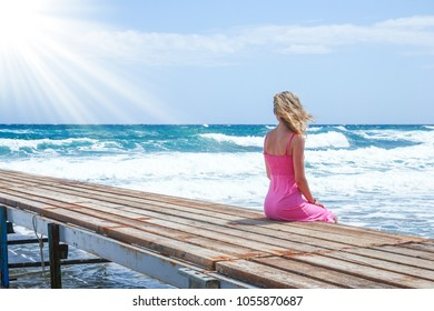 beautiful girl on the pier of the sea shore