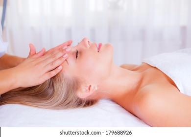 beautiful girl on reception at the masseur. facial massage