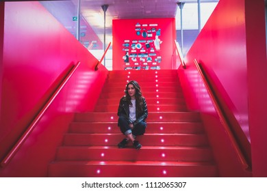 beautiful girl on red stairs with lights