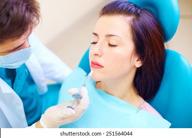 beautiful girl on rejuvenation procedure in beauty clinic, filler injection