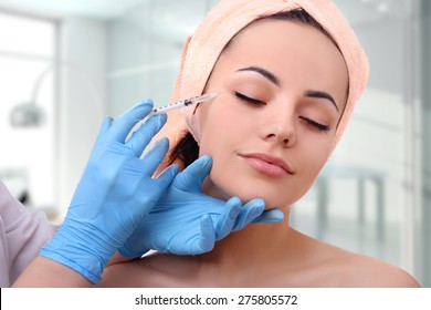 Beautiful girl on rejuvenation procedure in beauty clinic, filler injection.
