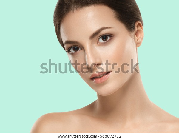 Beautiful girl on summer green trendy color background.