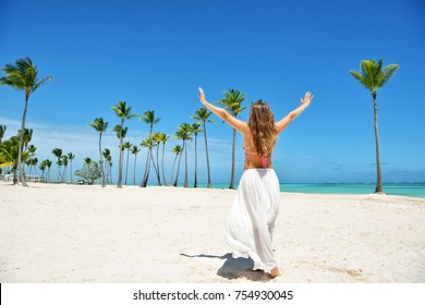 Beautiful girl on the tropical beach. Carefree woman on the beach.
