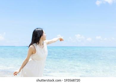 beautiful girl on the tropical island beach
