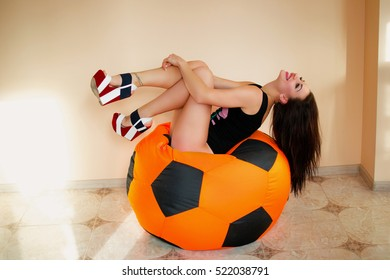 Beautiful girl and orange ball, soft